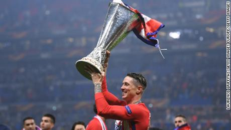 Fernando Torres celebrates his first major trophy for Atletico.
