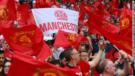 Manchester United fans cheer their team in the FA Cup semifinal.