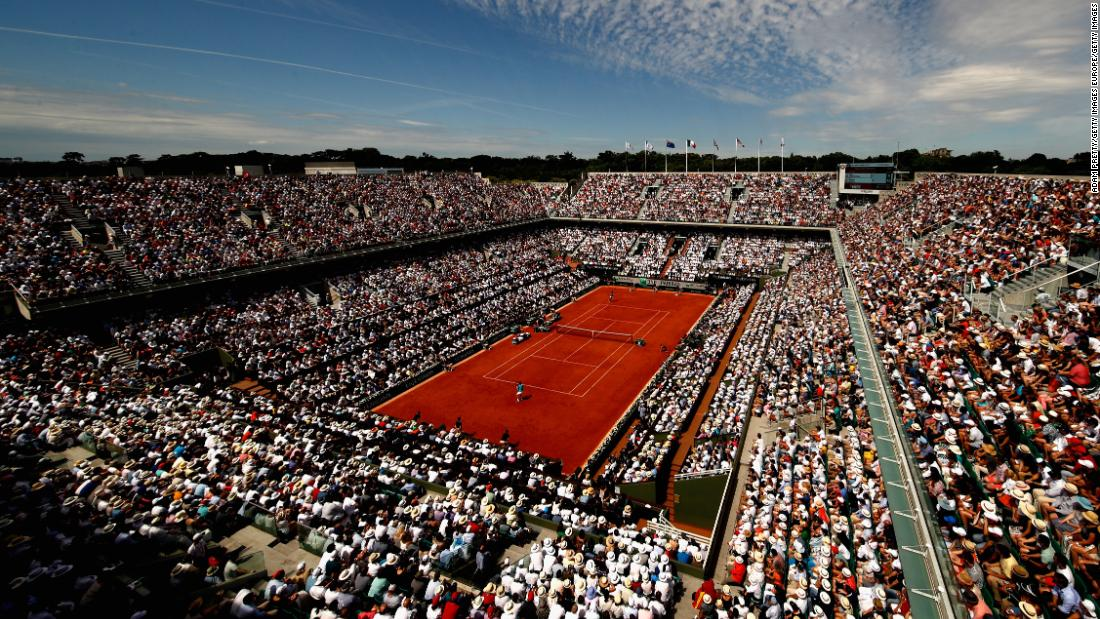 """Last year about 15,000 people packed into Roland Garros' Philippe-Chatrier court to watch <a href=""""https://edition.cnn.com/2017/06/11/tennis/french-open-nadal-wawrinka-decima/index.html"""">Nadal</a> make history as the only player in the modern era to win the same grand slam 10 times."""