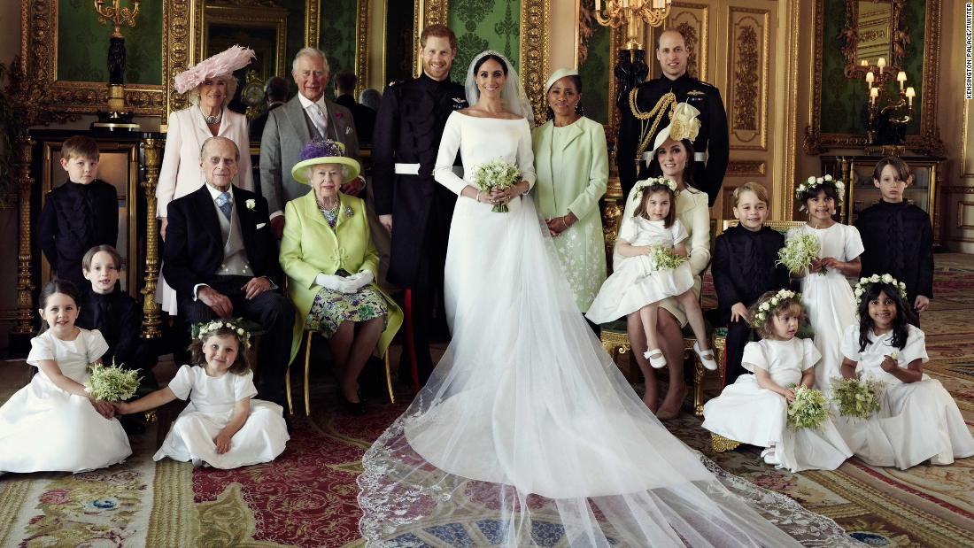 Prince Philip poses with the wedding party after Harry and Meghan's wedding in May 2018.