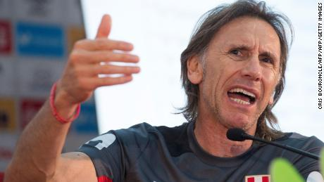 Peru's Argentine coach Ricardo Gareca protests the 14-month sanction in a press conference.