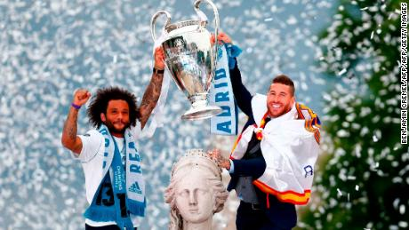 Real Madrid's Marcelo and Sergio Ramos hold the Champions League trophy.