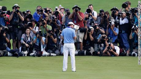 McIlroy celebrates a crushing eight-shot victory at the 2011 US Open, just two months after his Masters collapse.