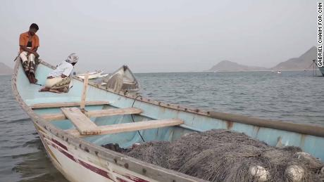 Fishermen at a village where human traffickers operate