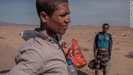 Ethiopian migrants on the road along the western coast of Yemen walking toward Saudi Arabia