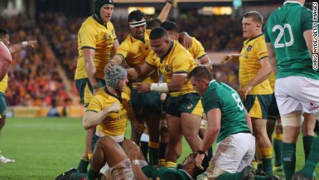 Australia's David Pocock celebrates after scoring against Ireland in Brisbane.