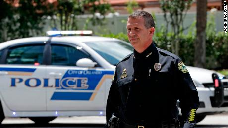 Orlando Police Chief John Mina arrives at an afternoon news conference during a hostage standoff Monday in Orlando.