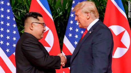 Trump and North Korea's Kim share historic handshake as summit begins