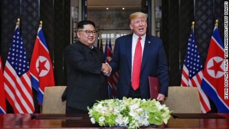 North Korean leader Kim Jong Un and with US President Donald Trump during their historic summit at the Capella Hotel on Sentosa island on June 12, 2018.