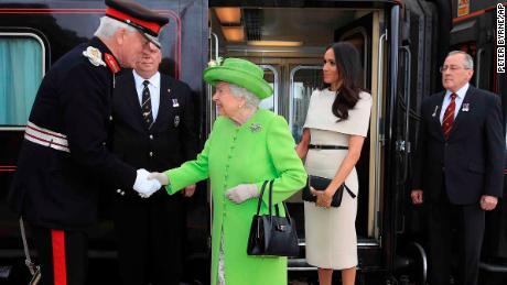 Queen Elizabeth II and the Duchess of Sussex arrive in Cheshire on Thursday.
