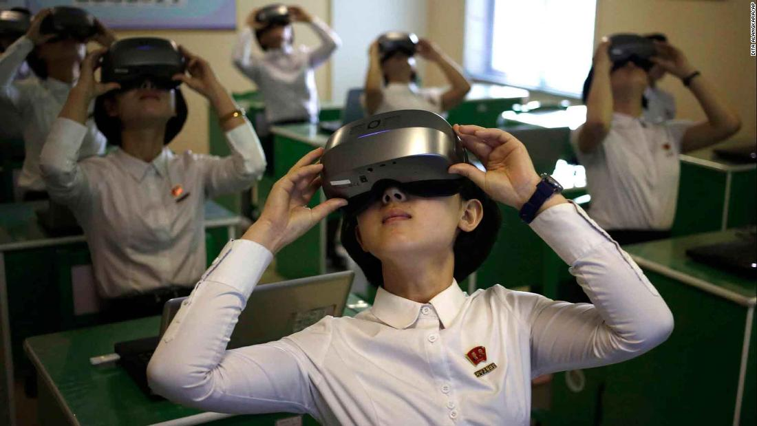 Students wear virtual-reality headsets at a teacher-training college in Pyongyang, North Korea, on Thursday, June 14.