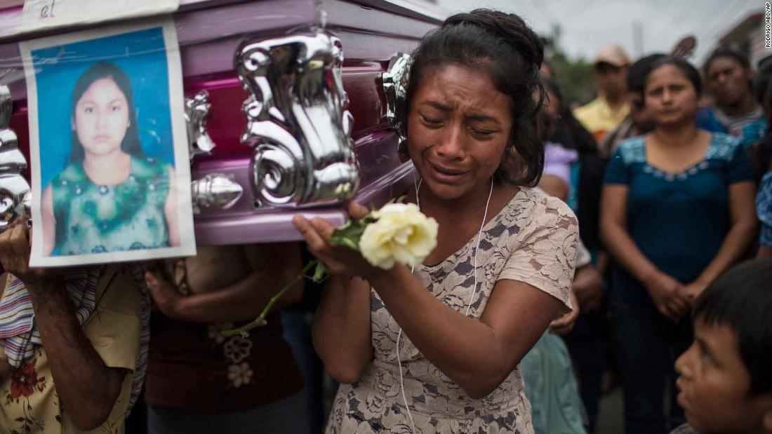 Yoselin Rancho cries while carrying the remains of her best friend, Etelvina Charal, in Alotenango, Guatemala, on Sunday, June 10. Charal was among those killed by  the Fuego volcano,  which erupted June 3 and covered nearby villages in ash.