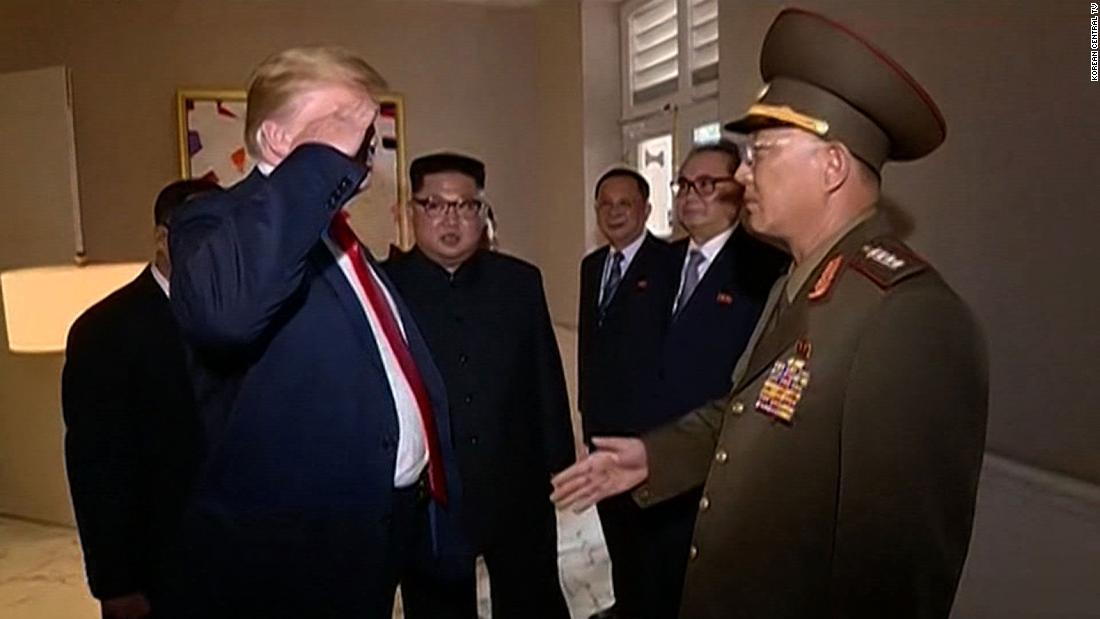 US President Donald Trump  returns a salute to a North Korean military general  during his summit with North Korean leader Kim Jong Un on Tuesday, June 12. This image was taken from video footage recently released by North Korean state media.