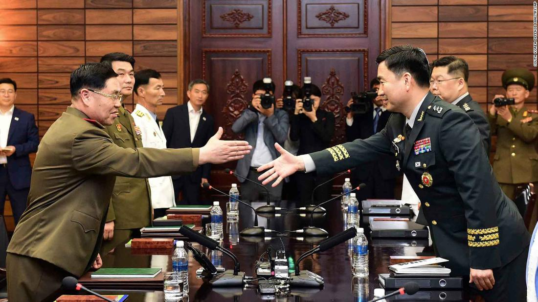 In this photo provided by South Korea's Defense Ministry, South Korean Maj. Gen. Kim Do-gyun, right, reaches out to North Korean Lt. Gen. An Ik San during high-level military talks on Thursday, June 14. In April, the leaders of North and South Korea met at  a historic summit  that ended with a declaration that the two countries -- who have been technically at war for almost 70 years now -- will sign a peace treaty later this year.