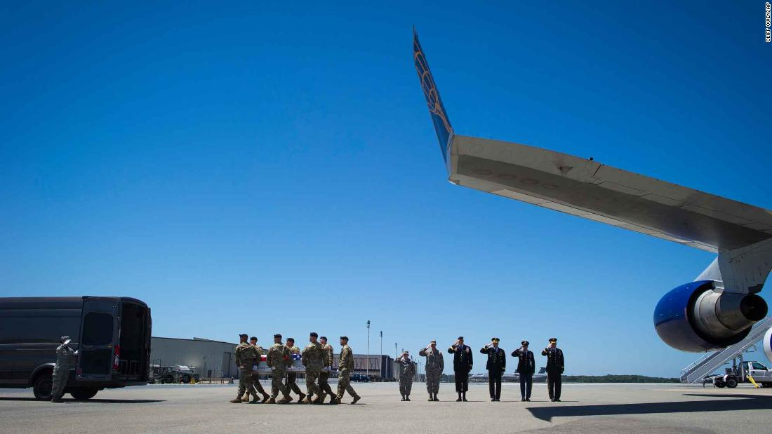 A US Army carry team transfers the remains of Staff Sgt. Alexander W. Conrad at Dover Air Force Base in Delaware on Tuesday, June 12. Conrad, a 26-year-old from Chandler, Arizona,  died while serving in Somalia.