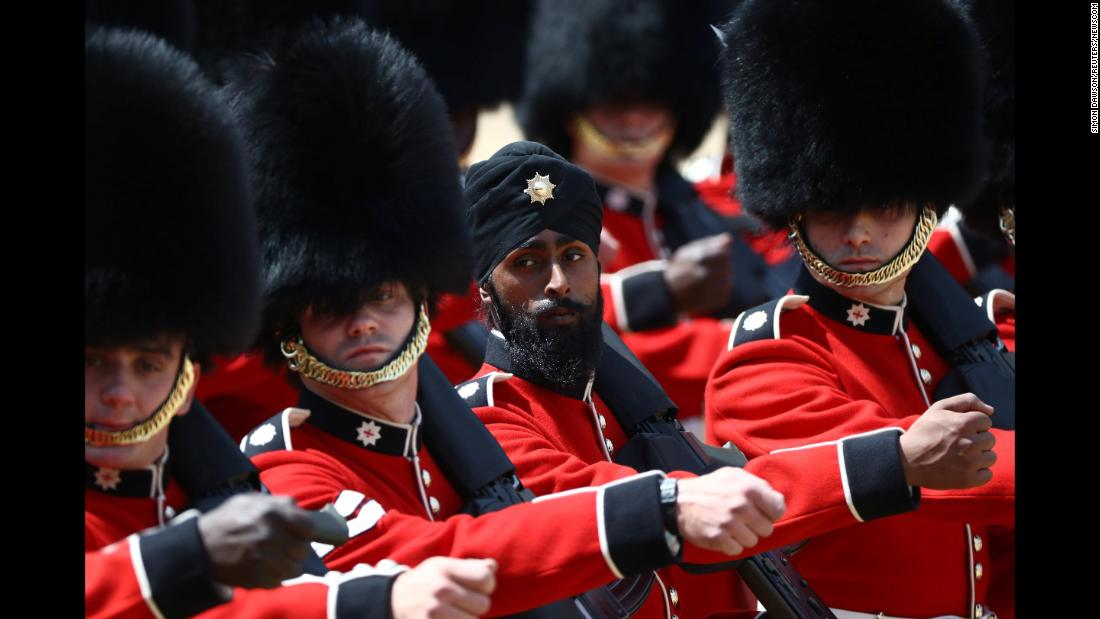 Members of the Coldstream Guards, a regiment of the British Army, march in London during the annual Trooping the Colour parade on Saturday, June 9. Charanpreet Singh Lall, 22, became  the first Coldstream Guardsman to wear a turban during the parade.