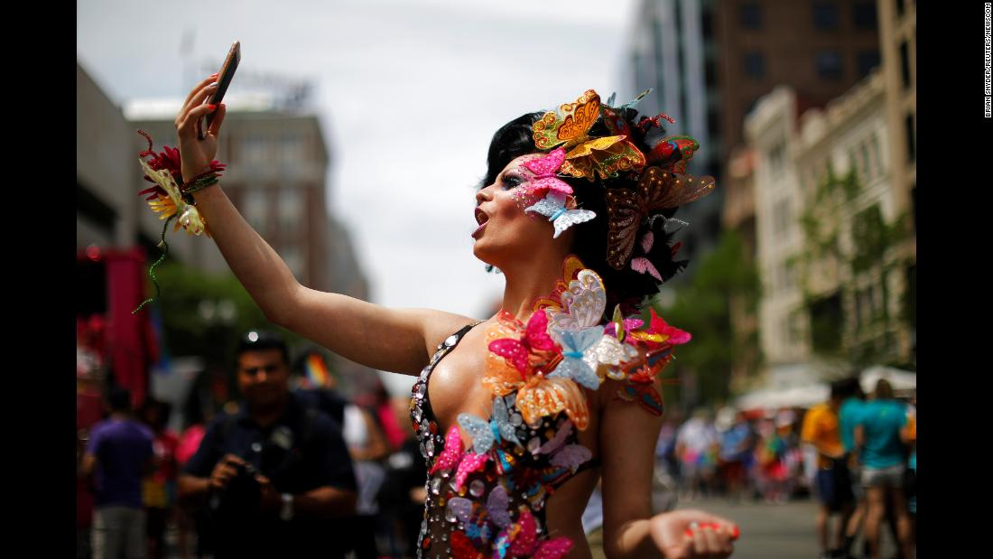 Karol Barrensche records a video of herself before marching in Boston's Pride Parade on Saturday, June 9.