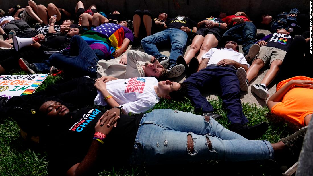 "Students from Marjory Stoneman Douglas High School participate in a ""die-in"" Tuesday, June 12, across the water from the Mar-a-Lago resort in West Palm Beach, Florida. Organizers behind  National Die-In Day  hoped the event would focus more attention on gun violence."