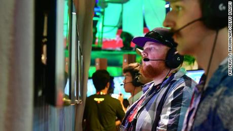 """Gamers play """"Fortnite"""" on PS4 consoles at E3 2018 in Los Angeles, California."""
