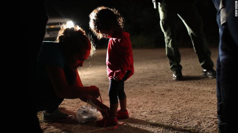 Border Patrol Agents Detain Migrants Near US-Mexico Border MISSION, TX - JUNE 12: U.S. Border Patrol agents take into custody a father and son from Honduras near the U.S.-Mexico border on June 12, 2018 near Mission, Texas. The asylum seekers were then sent to a U.S. Customs and Border Protection (CBP) processing center for possible separation. U.S. border authorities are executing the Trump administration's zero tolerance policy towards undocumented immigrants. U.S. Attorney General Jeff Sessions also said that domestic and gang violence in immigrants' country of origin would no longer qualify them for political-asylum status. (Photo by John Moore/Getty Images)