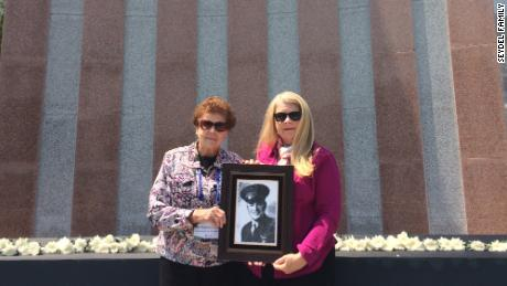 Rosanne Seydel and Ruth Hebert hold the portrait of First Lieutenant Karle Seydel, who was killed on December 7, 1950 during the Korean War.
