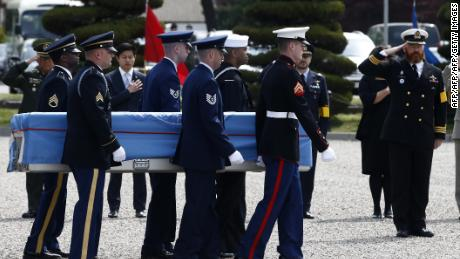 Honor guards carry a casket containing the remains of a United Nations Command soldier killed inside North Korea during the Korean War, during a joint repatriation ceremony at Yongsan garrison in Seoul on April 28, 2016.