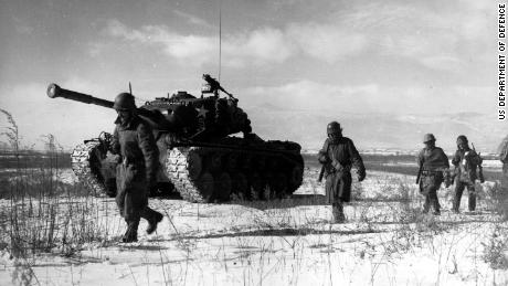 A column of troops and armor of the 1st Marine Division move through communist Chinese lines during their successful breakout from the Chosin Reservoir in North Korea. The Marines were besieged when the Chinese entered the Korean War Nov. 27, 1950, by sending 200,000 shock troops against Allied forces.