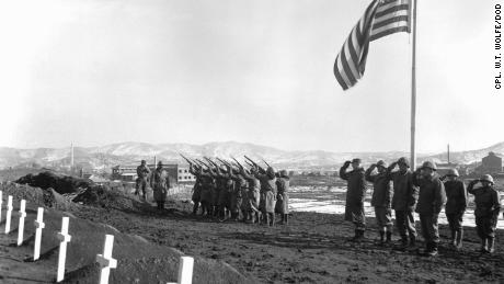 A Marine Corps honors brigade fires a volley over the graves of those who fell during the Battle of the Chosin Reservoir, in which over 10,000 Marines were killed.