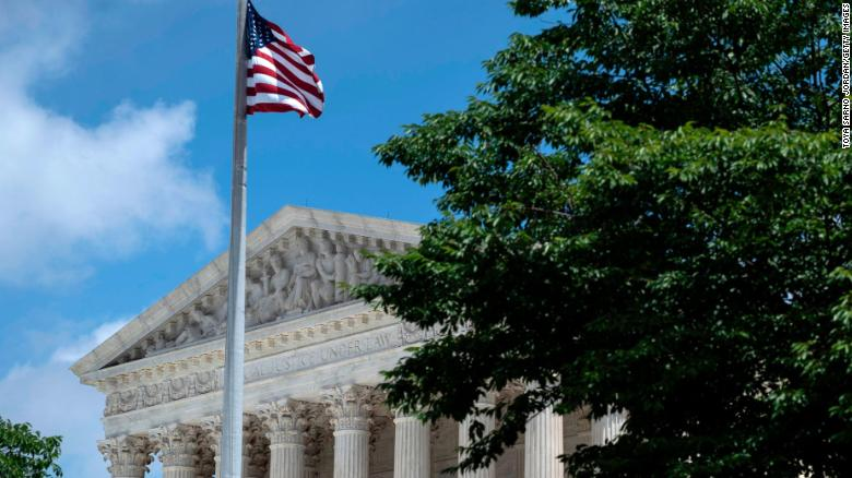 WASHINGTON, DC - JUNE 21: The U.S. Supreme Court is seen behind trees after it ruled that states may collect sales tax from retailers that do not have a physical presence, on June 21, 2018 in Washington, DC. (Photo by Toya Sarno Jordan/Getty Images)