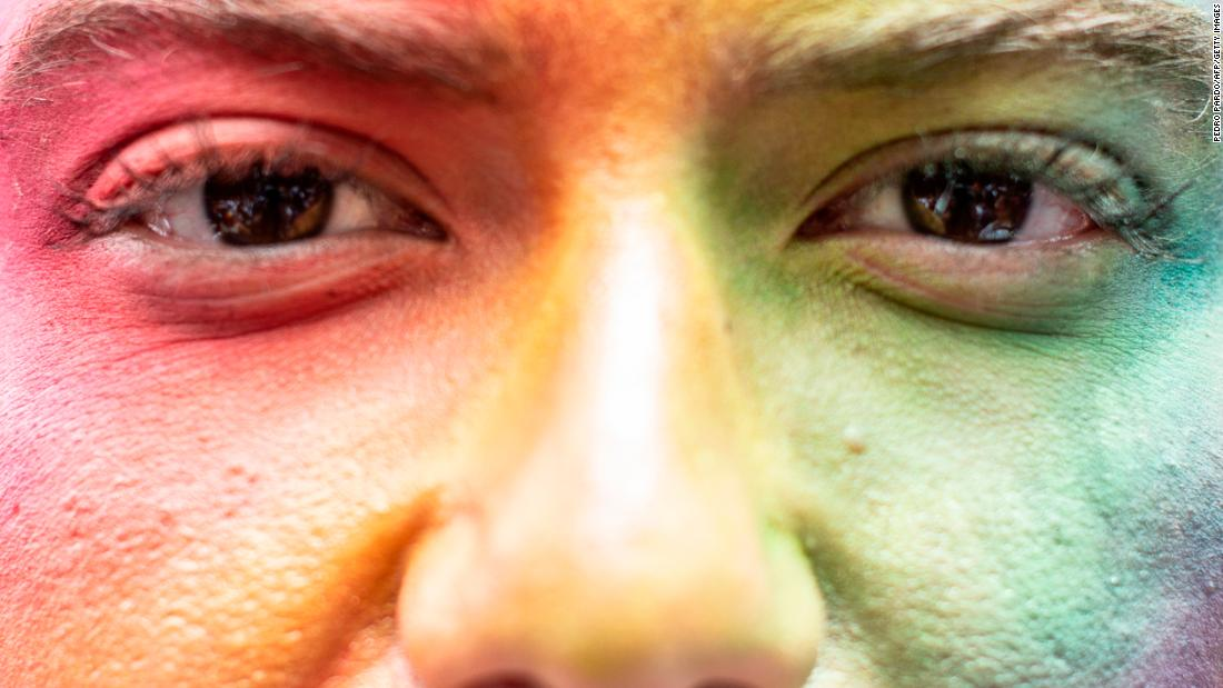 A person with a rainbow-painted face takes part in the annual Gay Pride Parade in Mexico City on Saturday, June 23.