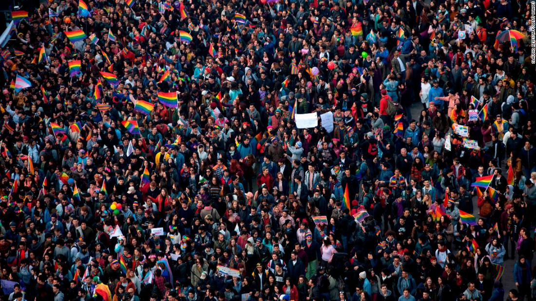People take part in the Gay Pride Parade in Santiago, Chile, on Saturday.