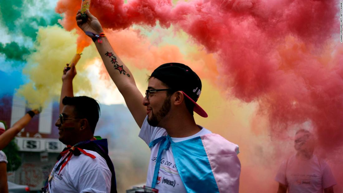 People take part in the Gay Pride Parade in Guatemala City, Guatemala, on Saturday.