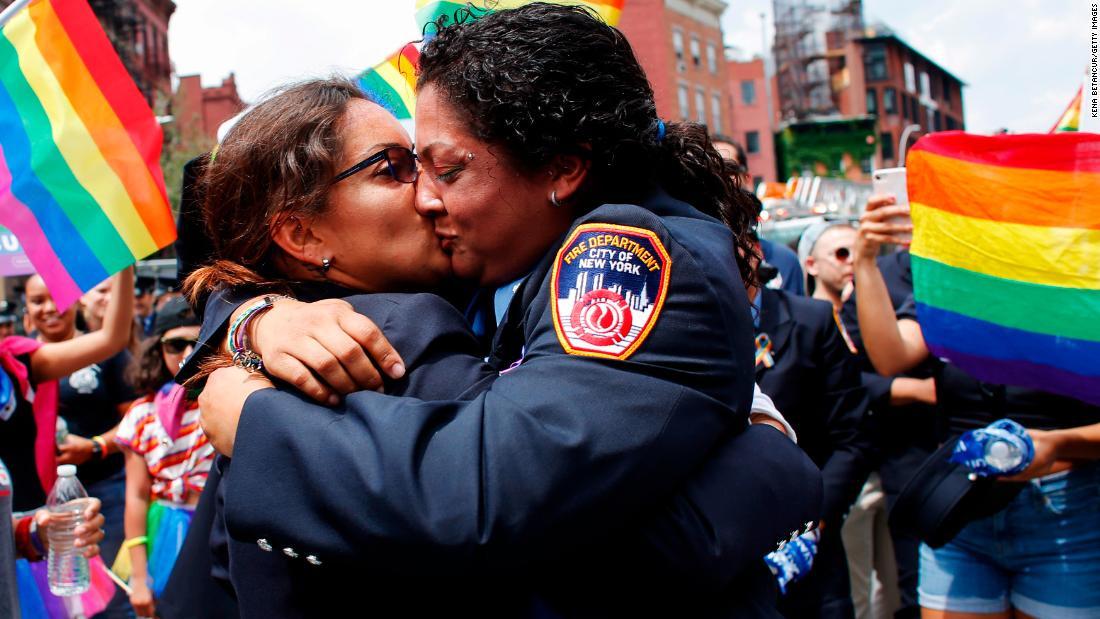 EMT Trudy Bermudez and paramedic Tayreen Bonilla of New York City Fire Department get engaged at the annual LGBT Pride March on Sunday, June 24. June is Pride Month, when the world's  LGBT communities come together and celebrate  the freedom to be themselves.