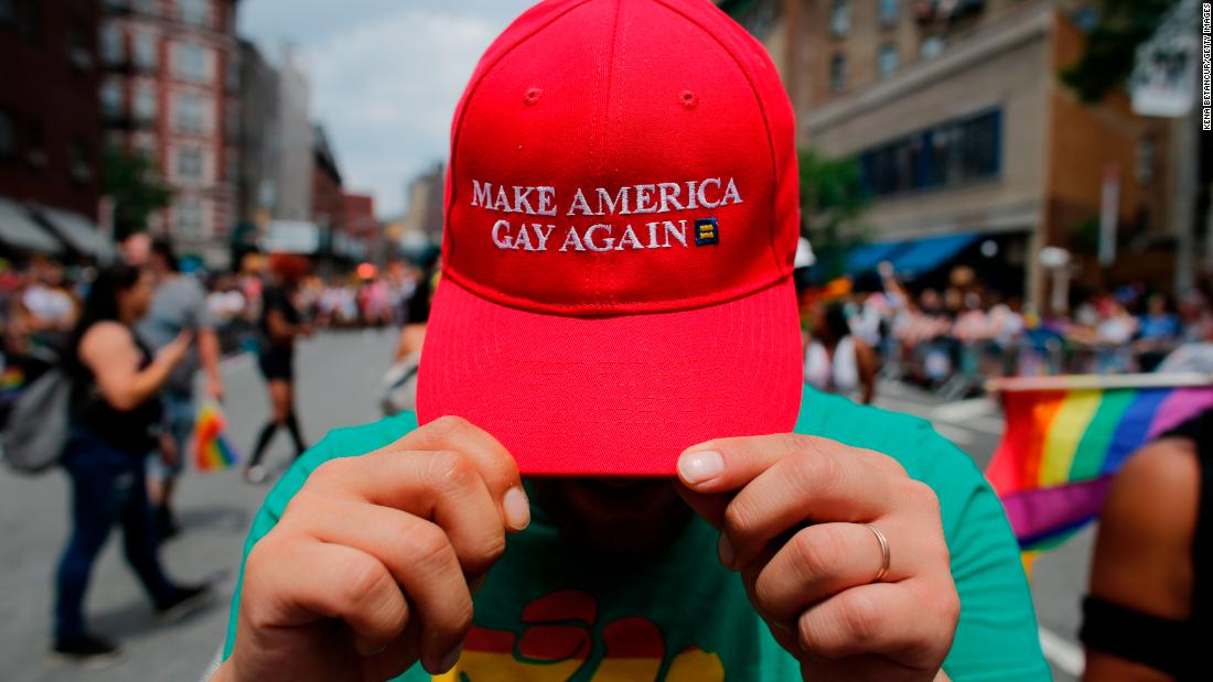 A reveler shows off his hat, which switches up President Trump's campaign slogan, at the New York march on Sunday.