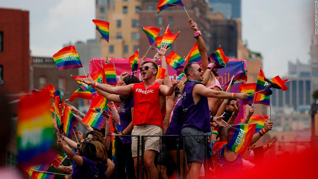People wave flags on a float at the  New York City Pride March on Sunday.