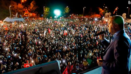 Turkey's President and leader of ruling Justice and Development Party (AKP) Recep Tayyip Erdogan addresses supporters.