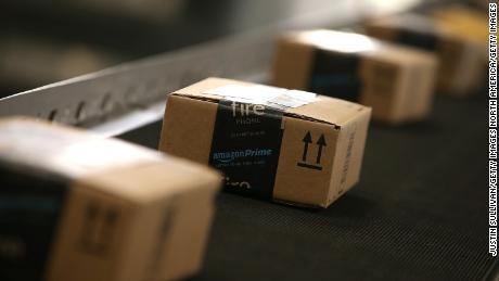 Boxes move along a conveyor belt at an Amazon fulfillment center.