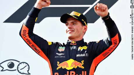Race winner Max Verstappen celebrates on the podium after taking victory in Austria for Red Bull.