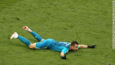 Akinfeev celebrates victory after saving two penalties