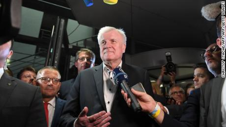 CSU's Seehofer offers to stand down over border bans