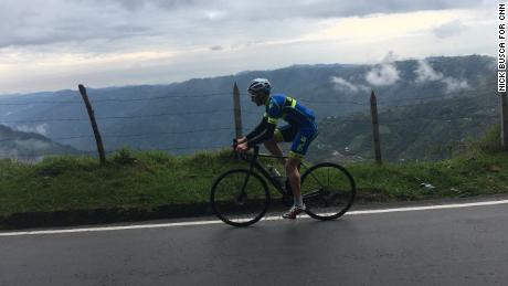 Hernan Acevedo, Cycling tour operator of Pure! Colombia, riding down the hairpin