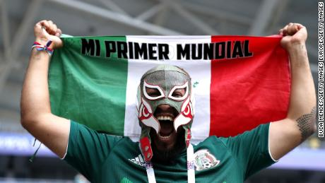 A Mexico fan watches on as his country plays Brazil.