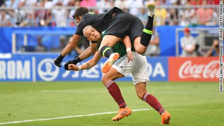 Javier Hernandez of Mexico collides with Alisson of Brazil.