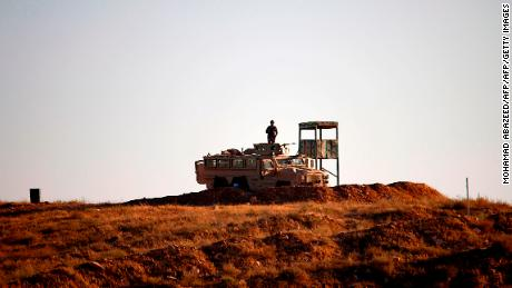 Jordanian soldiers control the border between Syria and Jordan on July 1
