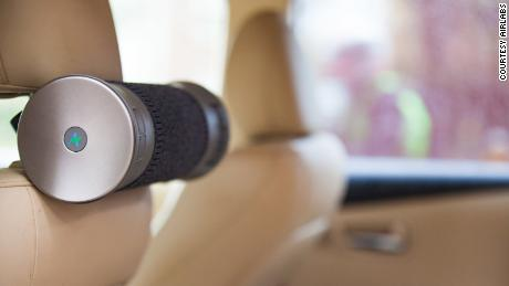 The Airbubbl filter attaches to a car's headrest.