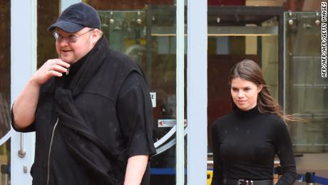 Kim Dotcom leaves with his girlfriend Elizabeth Donelly after his appeal for extradition in the Court Superior of Auckland on August 29, 2016.