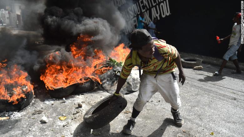 Looting follows protests in Haitian capital