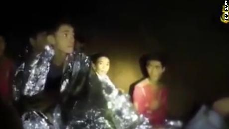 Chanin Viboonrungruang (center), also known as Titun, is seen here on Thai Navy video filmed inside the cave.