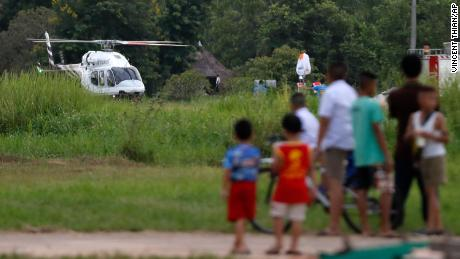 It is believed that a helicopter carries one of the children rescued from the Flooded Caves.