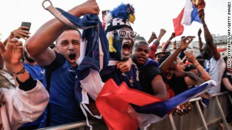 French football fans celebrate in Paris.